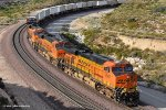 BNSF 7507 (ES44DC) swings through the curves at Davis Ranch (Cajon Pass Ca). 7/10/2010