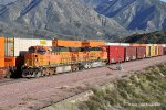 BNSF ES44DC's #7735 & 7768 with an eastbound manifest freight meet an L.A. bound stack train at Cajon. 3/15/2010