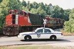 A JPD car parked in front of WTNN 3576 after a car struck the lead locomotive on North Royal St.