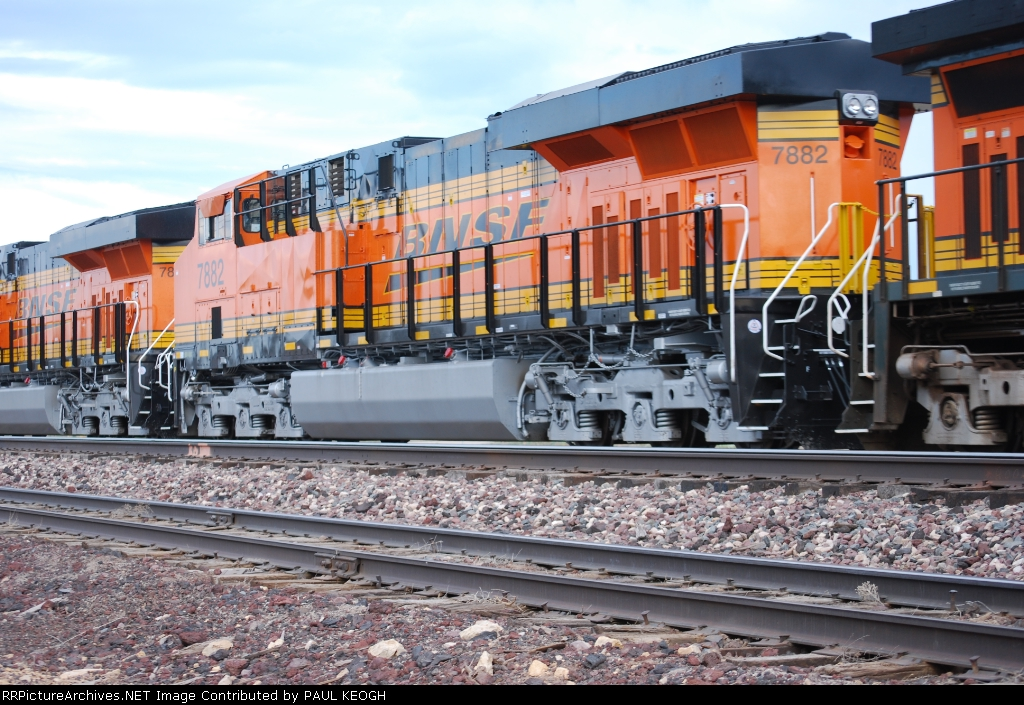 BNSF 7882 # 2 Unit behind her sister (lead unit) BNSF 7883 roll by me as they pull their first Revenue run west since leaving the GE Locomotive Plant in Erie, PA.