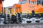 Close up shot of the cab of BNSF 7882 with the rear of BNSF 7883 (Lead Unit) as they roll past me.