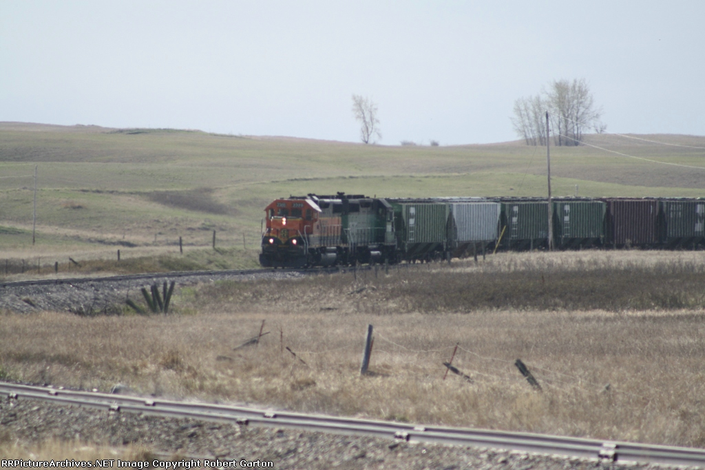 BNSF 2328 Brings Empties to be Loaded at the Local Elevator