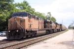 Westbound hotshot Q091  rolls thru town heading back to home rails at Chicago