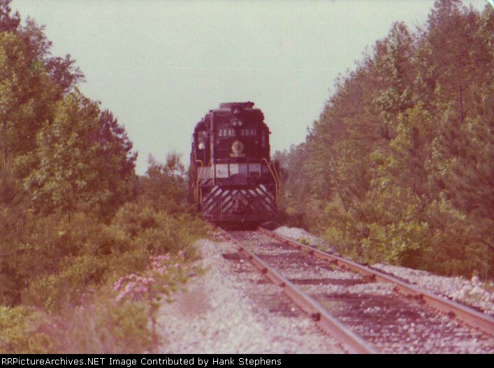 The Opelika Switcher job heads from  the Uniroyal Tire plant back to the main on the lead in the early 1980s.  The plant finally closed in 2010 leaving the branch idle with no other industry.