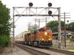 BNSF 5223 leads doublestacks east under the westbound signals for the UP diamonds