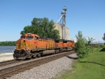 BNSF 5607 & 9330 roll south through town with taconite loads