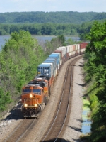 BNSF 7457 leads S-SEACHC1 south along the river