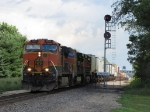 BNSF 1009 leads its' westbound train off the double track and through the shadow of the smallest cloud in the sky