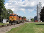 BNSF 5223 races west with 3 more Dash-9's