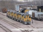 UPY 1040 sits tied onto 2 GP40-2's and 4 Dash-8's