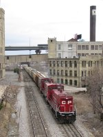 CP 1447 & 1446 switch a cut of cars out the east end of Muskego Yard