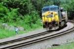 Mother and Son wacthing CSX 338 pass by them.