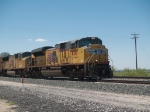 UP 8318 leads an EB autorack/doublestack at 2:02pm