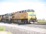 UP 7884 leads an EB doublestack at 10:51am
