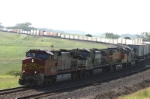 Intermodal train gets ready to overtake a freight