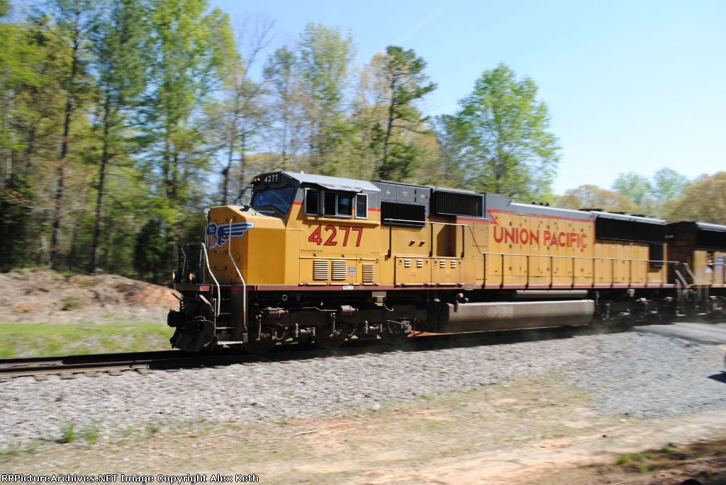 A Union Pacific SD70M Leads a Military Train