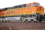 BNSF 7810 zips by me as she rolls eastbound.