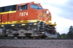 BNSF 7874 rolls by me close up as she is nsf 7874moving at track speed of 55 MPH.