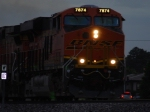 Close up shot of the front end of BNSF 7874 as she rolls east at dusk.