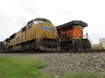 EB NS intermodal with UP leader passing BNSF empties