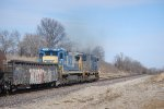 CSX 7583 rumbles by playing second fiddle and with mismatched number boards.