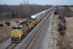 UP 8487 heads up a long auto rack in the dead of winter.