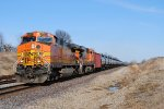 BNSF 4467 and helper go west with loaded Ethanol .