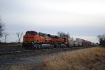 ES44C4 BNSF DPU 6860 pushes west with stacks.