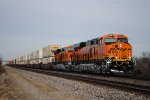 BNSF 6852 a brand spankin new ES44C4 blasts by me at Gibbs Missouri