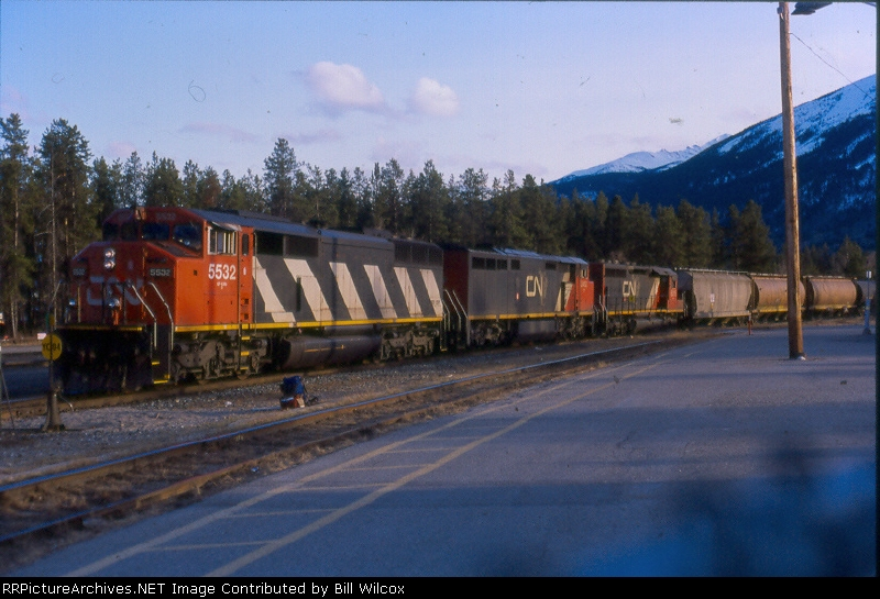 CN 5532 leads an eastbound into the division point and past the VIA station