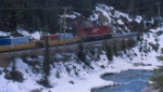 CP 8734 pulls a westbound along the Kicking Horse River