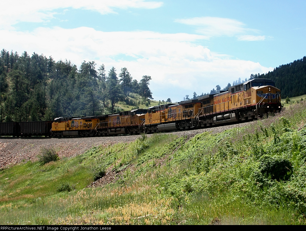 UP 6728 leads a quartet of AC4400's up the hill with a train of empties