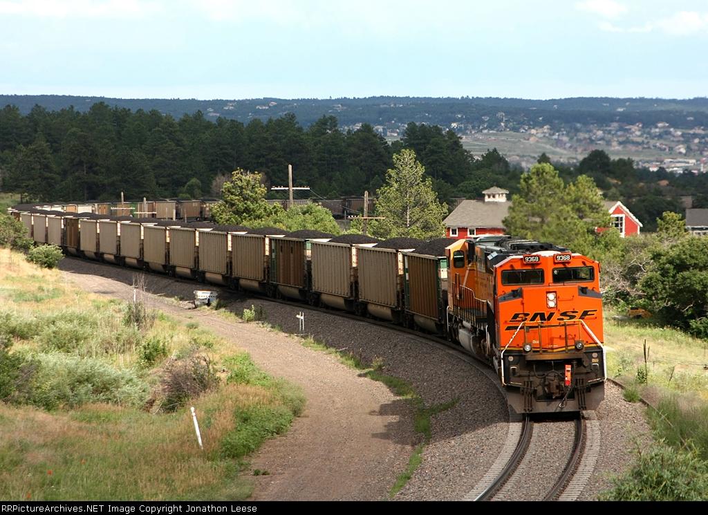 DPU's idle as a SB coal train heads down the hill