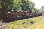 Westbound manifest rolls down siding