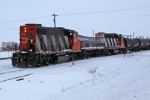 CN 4808, slug 518 and CN 7516 switch CN's Clover Bar yard  (and it must be very cold standing on the front of the locomotive!)