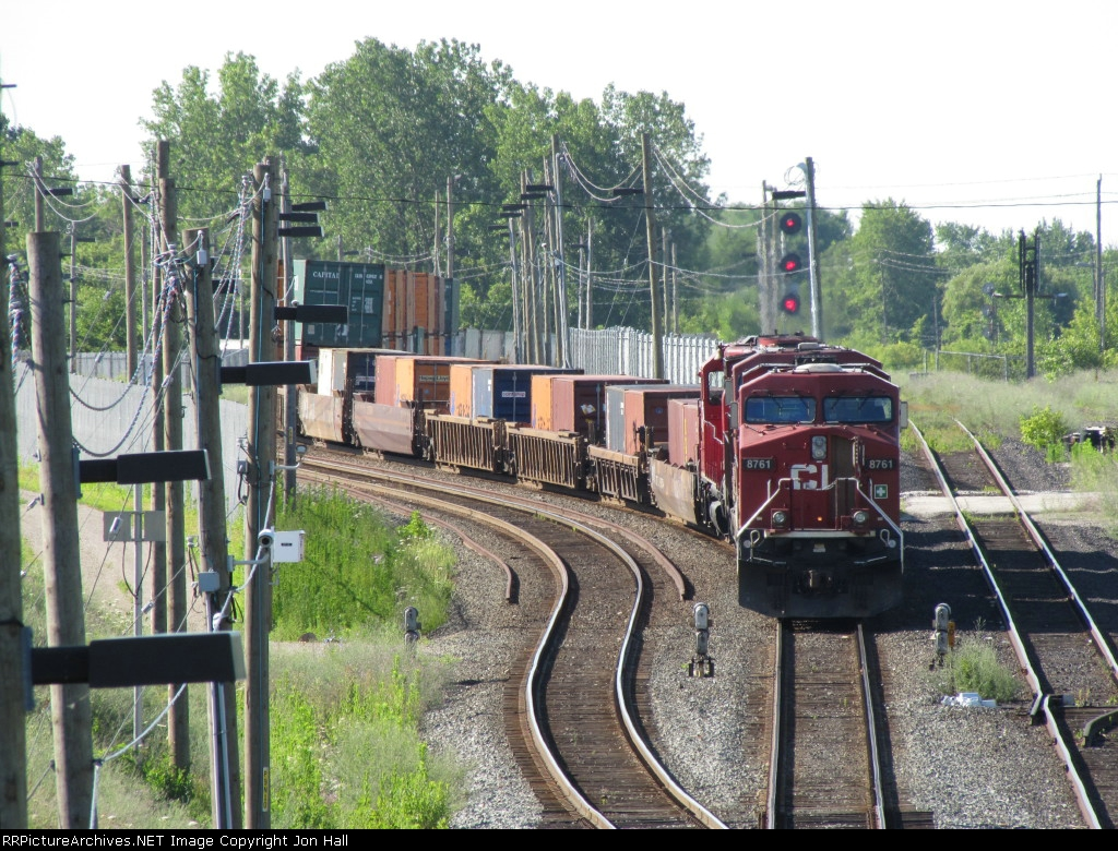 A CP westbound sits just above the tunnel signals awaiting its turn to head into the USA