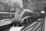 "Ex LNER A4 class 4-6-2 60010 ""Dominion of Canada"" waits to depart Kings Cross with an express to the north."