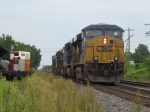 CSX 5470 has 5 units in tow as it pauses by one of the museum's engines