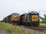 CSX 2246 pushes on a eastbound rail train as CSX 5470 waits for it to pass with a six-unit power move westbound