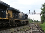 CSX 5470 leads the light power move under the signal tower