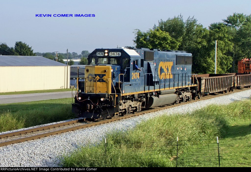 CSX SD50-2 2474 leads a northbound work train loaded with equipment