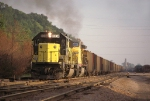 C&NW 8004, EMD SD60, notches out working eastbound coal loads passing the C&NW yard