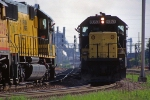 C&NW 8053 - 7004, EMD SD60, SD50, East and westbound coal trains meet