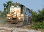 CNW 4556 kicking up some dust
