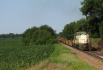 CNW 4556 looking at home rolling through the fields
