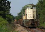 CNW 4556 struggles to move a mile of storage cars through the sags south of Bowersville