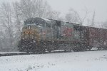 KCS 3940 shoving NS 340 over the hill in a blizzard