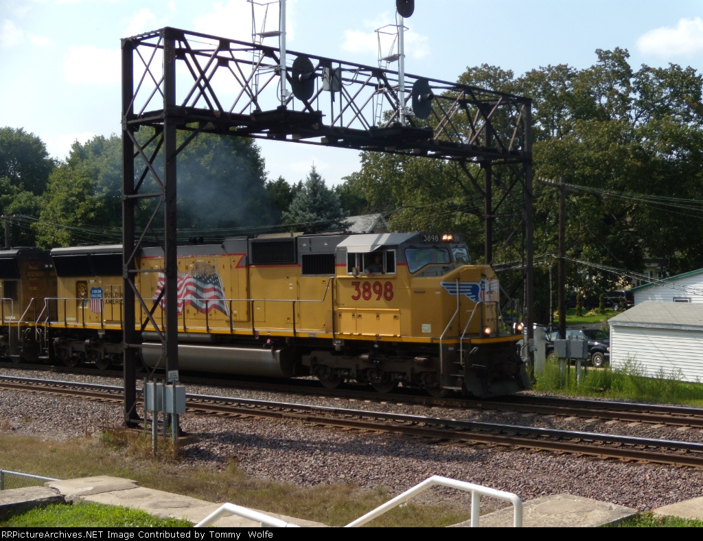 UP 3898 leads an intermodal as it passes under the UP signal Bridge at Rochelle