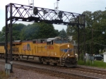 UP 7806 leads an intermodal as it passes beneth the UP signal bridge at Rochelle