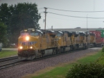 UP 7357 leads a 4 unit set of power on the point of an intermodal in the rain